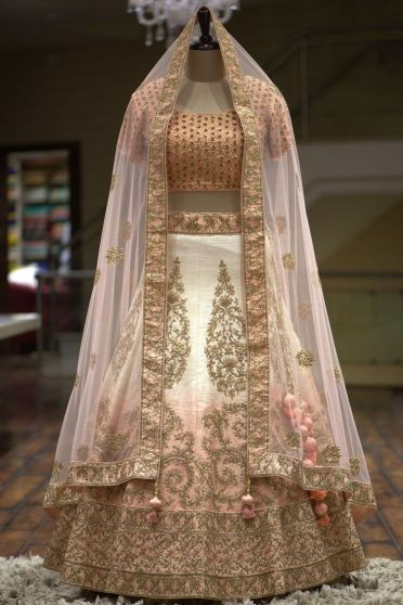 White and Gold Embroidered Heavy Bridal Lehenga